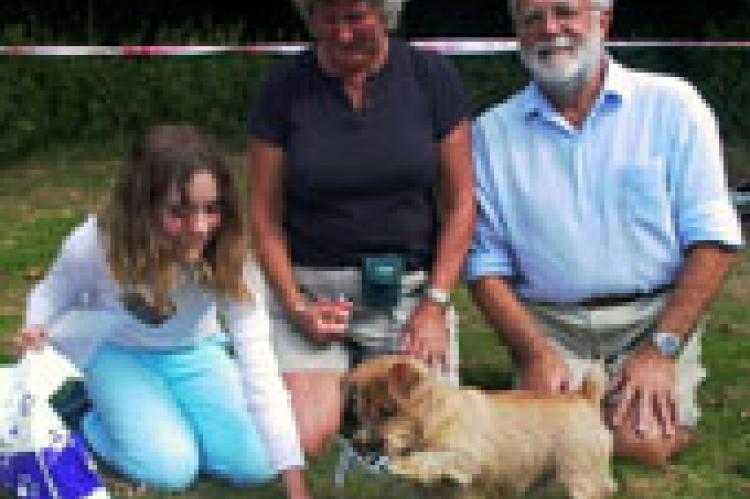 "Skipper won the ""Baginton Bullet"" This is his family with his handler Sally"
